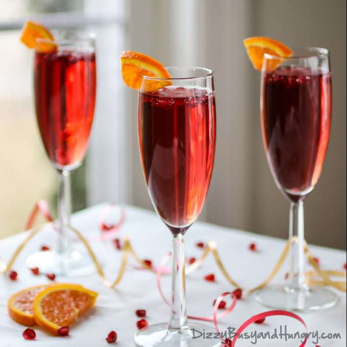Pomegranate Orange Spritzer | DizzyBusyandHungry.com - Easy, delicious, fun, and festive! #cocktail #pomegranate #spritzer