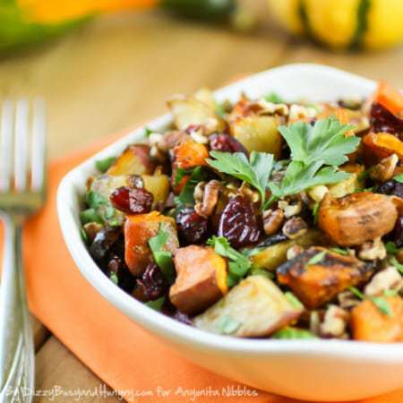 Roasted Potato Medley | DizzyBusyandHungry.com - Sweet potatoes, white potatoes, red potatoes, and red onions roasted in garlic with olive oil and tossed with dried cranberries and pecans. #potatoes #sidedish #cranberries #holidays