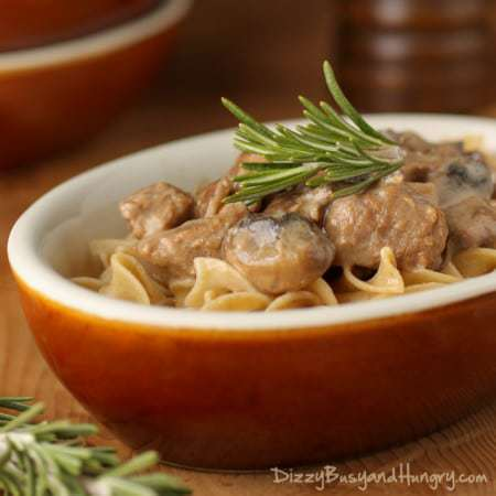 Crockpot Beef Stroganoff | DizzyBusyandHungry.com - Tender beef and savory mushrooms in a creamy, tangy sauce. This classic comfort food is a family favorite!