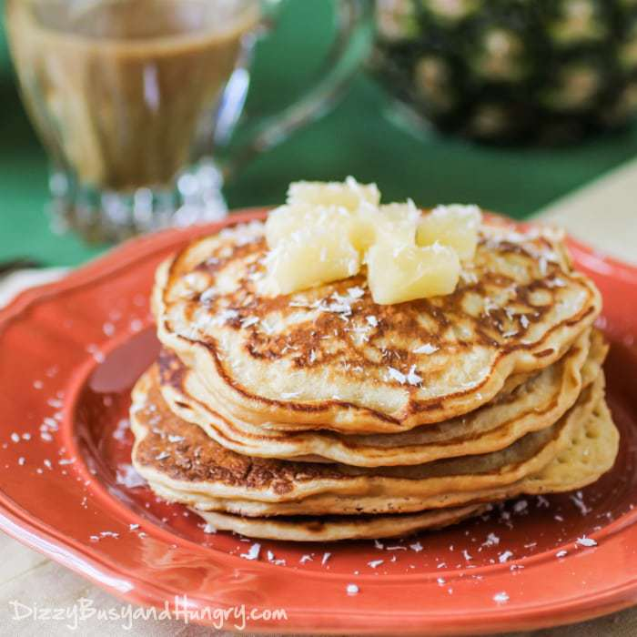 Pina Colada Pancakes #SundaySupper | DizzyBusyandHungry - Fluffy, melt-in-your-mouth pineapple pancakes drizzled with a deliciously sweet coconut syrup!