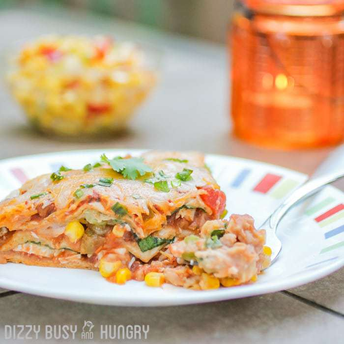 Fiesta Lasagna   DizzyBusyandHungry.com - Layered whole wheat tortilla casserole with refried beans, chicken, salsa, and lots of melted cheese!
