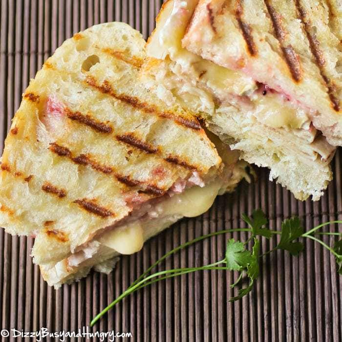 Turkey and Brie Grilled Cheese | DizzyBusyandHungry.com - Creamy brie, roasted turkey breast, and a cranberry spread stuffed between two pieces of sourdough bread and grilled until crispy.