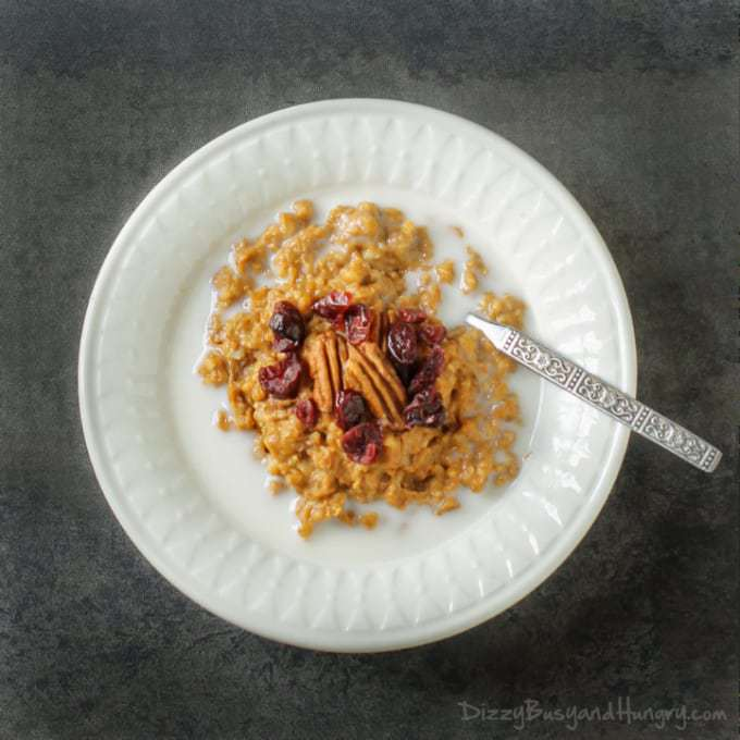 Pumpkin Spice Overnight Oatmeal | DizzyBusyandHungry.com - Warm and delicious, this oatmeal cooks overnight in the crock pot and provides a healthy, filling breakfast for the whole family! #oatmeal #slowcooker #pumpkin