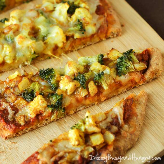 Curried Veggie Pizza   DizzyBusyandHungry.com - Individual vegetarian pizzas slathered with curry-spiced pizza sauce and loaded with delicious veggies!