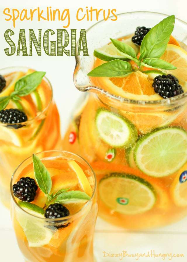 Sparkling Citrus Sangria   DizzyBusyandHungry.com - Refreshing and crisp adult beverage made with pineapple juice and ginger ale, perfect for a warm summer afternoon!
