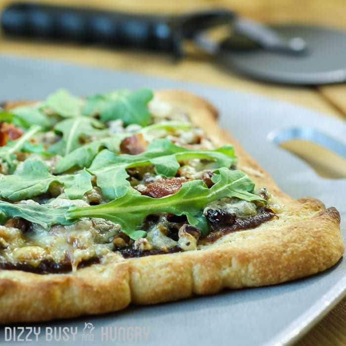 Caramelized Onion Bacon Pizza | DizzyBusyandHungry.com - Not your ordinary pizza. This amazing compilation of flavors will have your family raving with every bite!
