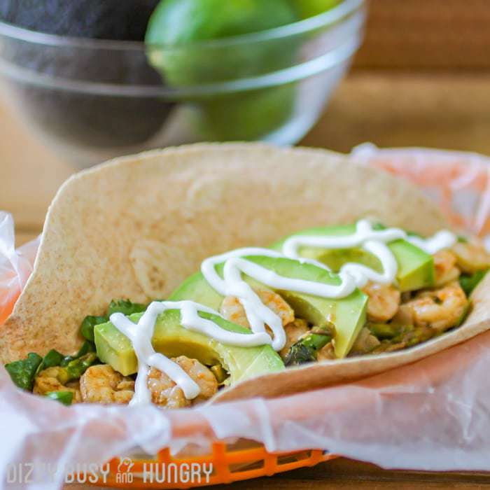 Chipotle Shrimp and Asparagus Soft Taco | DizzyBusyandHungry.com - Spicy, zesty shrimp cooked in beer and then coated with a flavorful chipotle-lime sauce served over a bed of greens in a whole wheat tortilla.
